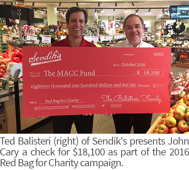 Ted Balisteri presents John Cary a check for $18,100 as part of the 2016 Red Bag for Charity campaign.