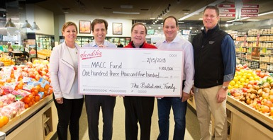 Sendik's Presents MACC Fund with a check for $103,500